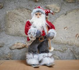 Père Noël 30cm sur ski avec hotte dans son dos - ROUGE